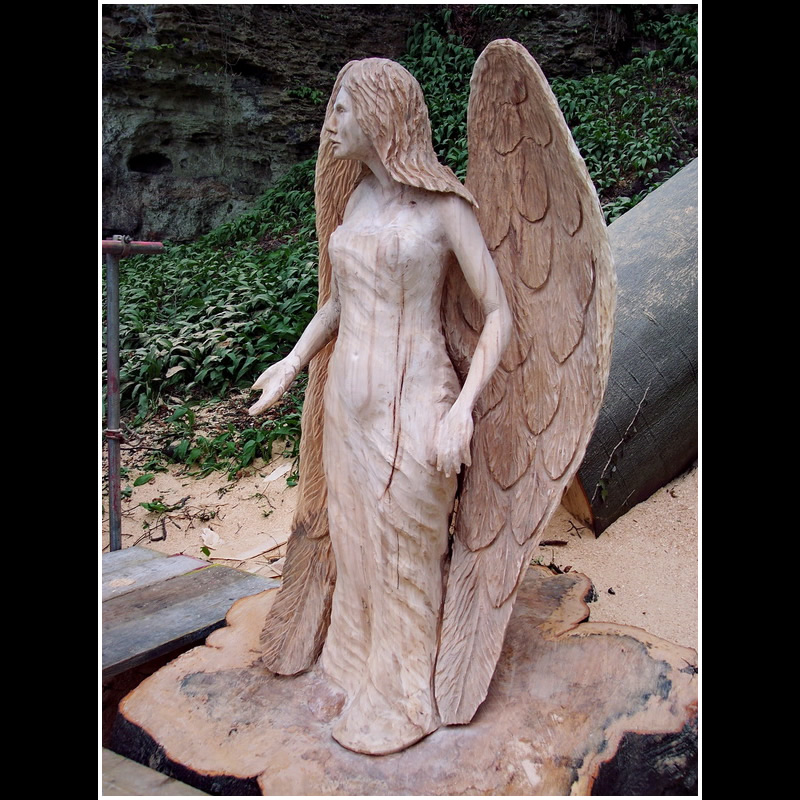 Chainsaw carving angel mother shiptons cave