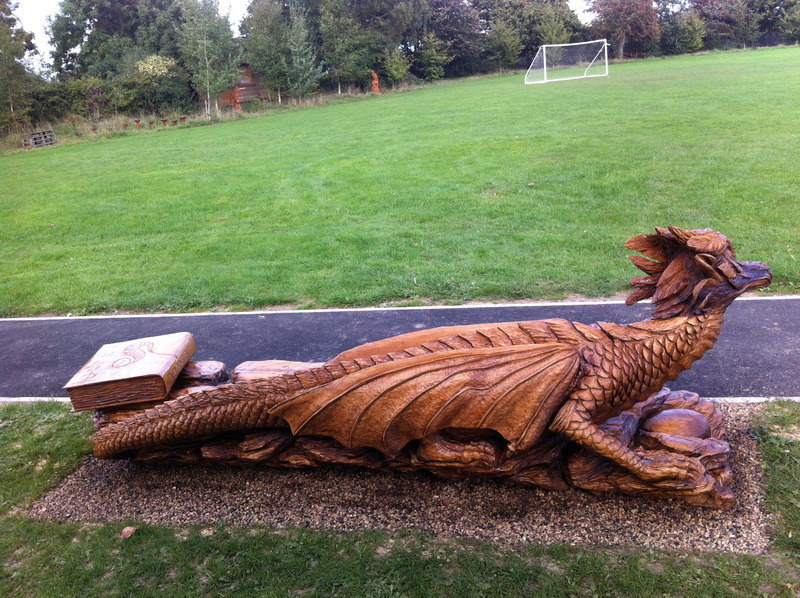 Chainsaw carving dragon bench