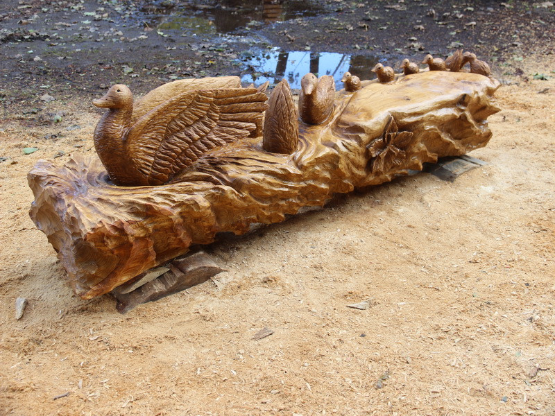 Chainsaw carving duck duckling bench
