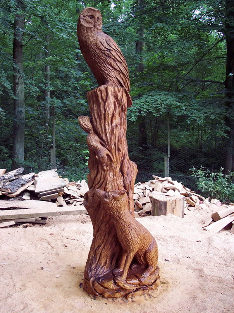 Chainsaw carving fox and owl