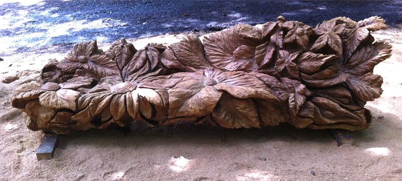 Chainsaw carving oak flower bench